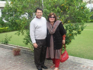 Dr. Afshan Hashmi ( Seen on Right) with her husband Mustafa Hashmi (seen on Left) standing inside VC Lodge in front of memorable tree of small oranges which brings about lot of memories for Dr. Afshan Hashmi of AMU VC Lodge.
